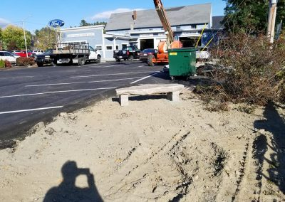 Four Seasons Landscaping NH VT ME Leo J Enos hardscaping commercial Lancaster National Bank Building Lancaster New Hampshire Vermont Maine patio guardrail