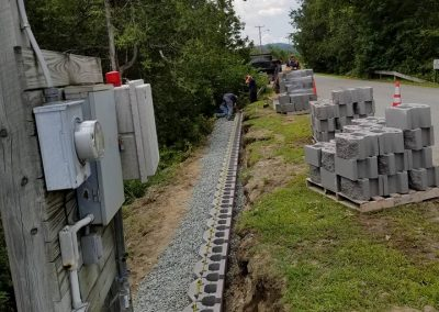 laying a strong and true foundation for the retaining wall